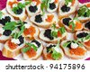 sandwiches with salmon and sturgeon caviar and butter - stock photo