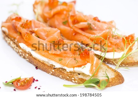 sandwiches with salmon caviar and greens adorned