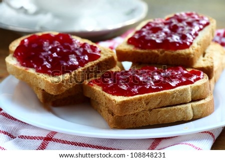 Sandwiches with white bread spread with homemade cherry jam