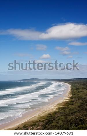Sandy beach and reflected sky - stock photo