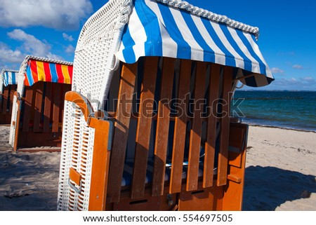 Sandy beach and traditional wooden beach chairs on Rugen island, Northern Germany, on the coast of Baltic Sea