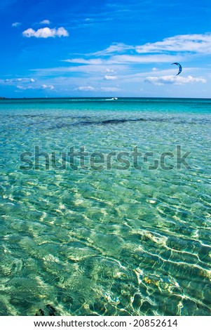 sandy beach and transparent water of the sea in Sardinia - stock photo