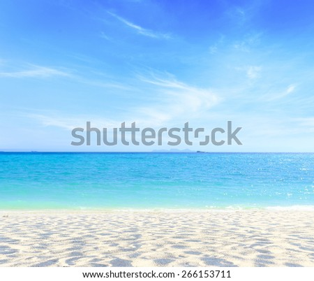 Sandy beach backdrop with turquoise water and bright sun light. Summer holidays concept. World oceans day concept. - stock photo