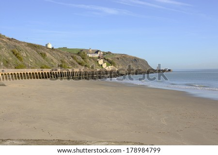 Sandy beach by the harbor at Folkestone in Kent. England - stock photo