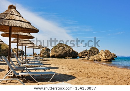 Sandy beach detached by small rocks on Zakynthos, Greece. - stock photo