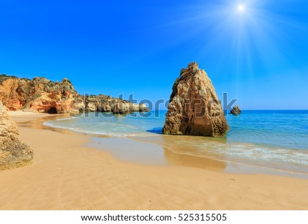Sandy beach Dos Tres Irmaos sunshiny summer view(Portimao, Alvor, Algarve, Portugal).