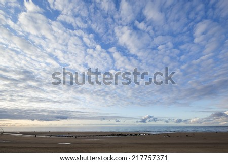 sandy beach in galicia, spain at sunset - stock photo