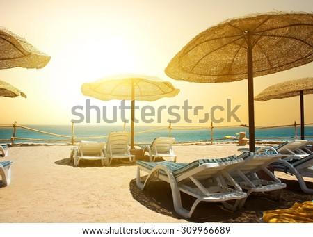 Sandy beach near red sea at sunset - stock photo