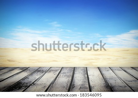 Sandy beach on sunny summer day with wooden walkway - stock photo