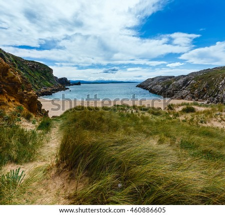 Sandy beach (Spain) Atlantic Ocean coastline landscape.