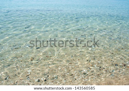 Sandy bottom through clear transparent sea - stock photo