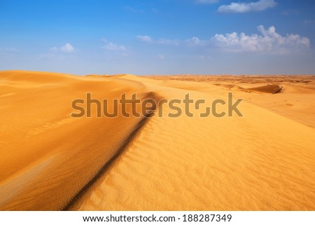 Sandy dunes in the desert near Abu Dhabi, United Arab Emirates - stock photo