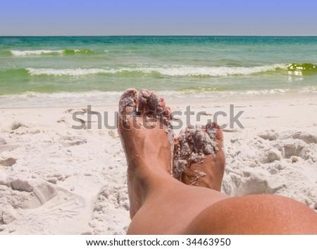 Sandy feet at beach Florida Gulf Coast - stock photo