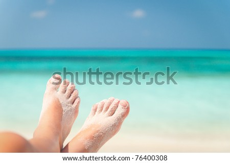 sandy feet on the beach - stock photo