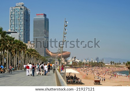 Sandy, palm-fringed beach at Barcelona's Port Olympic - stock photo