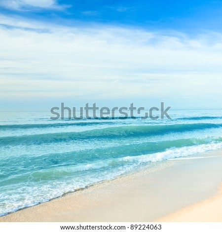 Sandy tropical beach in summer sunny day - stock photo