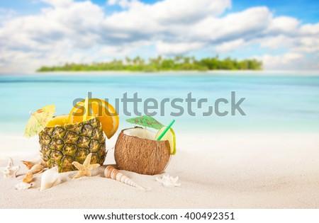Sandy tropical beach with summer drinks - stock photo