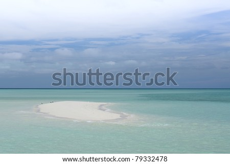 Sandy white beach on tropical island - stock photo