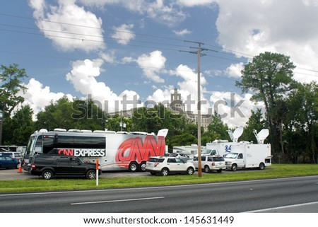 SANFORD, FL - JULY 9, 2013: Media covering the Zimmerman murder trial at the Seminole County Criminal Justice Center in Sanford, Florida, on July 9, 2013. - stock photo