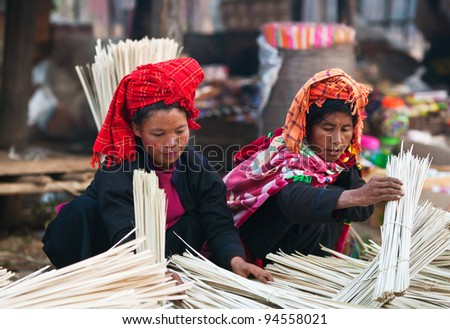 SANGHAR, MYANMAR - JANUARY 17: An unidentified Pa-O tribe women posing for the photo during the local Htamanu Pagoda Festival on January 17, 2011 in Sanghar Village, Shan state, Myanmar - stock photo