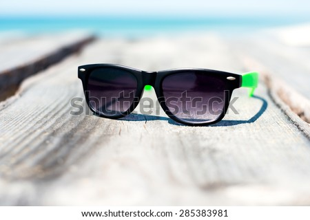 sanglasses beach vacation, stylish and protect your eyes from the bright sun - stock photo