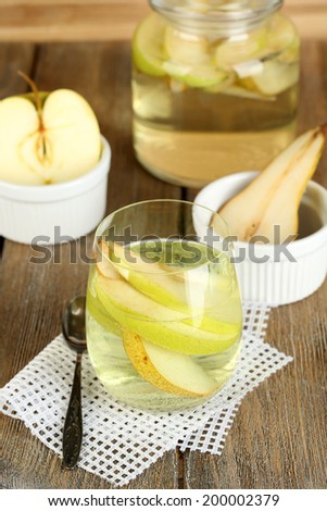 Sangria drink on wooden background - stock photo