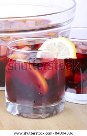 Sangria in glass bowl on wooden board, closeup - stock photo