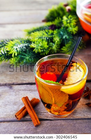 Sangria in glass with Christmas decoration on wooden table close up - stock photo