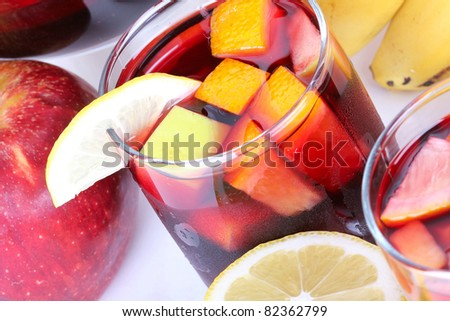 Sangria in glasses, closeup on white table - stock photo