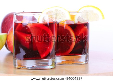 Sangria in glasses on wooden board, closeup - stock photo