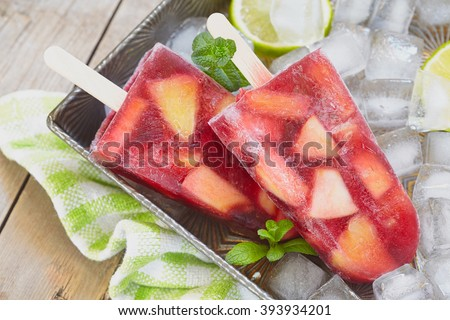 Sangria popsicles with fruits - stock photo