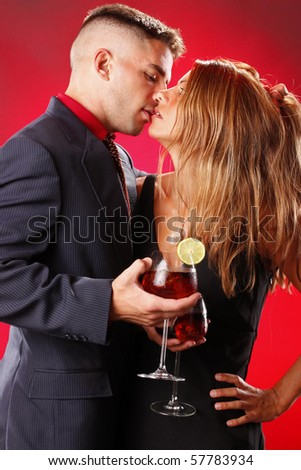 Sangria wine cocktail and passion couple - stock photo