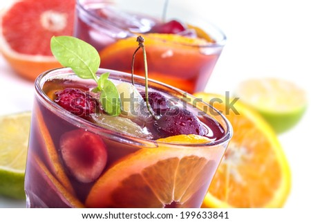 Sangria with citrus and other fruit on a white background - stock photo