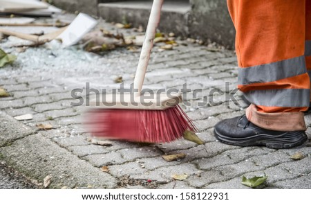 sanitation worker cleaning the street - stock photo