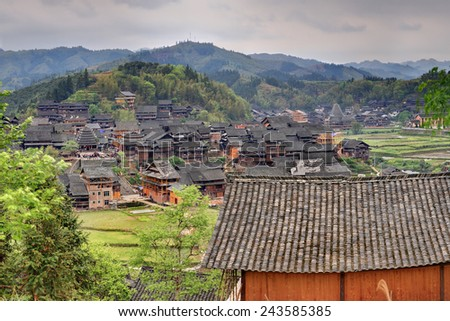 Sanjiang, Guangxi Province, China - April 6, 2010:  Rural China, Zengchong Dong ethnic minority Village, Here live the Dong tribe, wooden houses of farmers middle of the forest and mountain slopes.  - stock photo