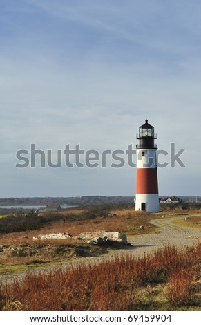 Sankaty Head Light Lighthouse on island of Nantucket Massachusetts USA built 1850 wide-angle view across the moors in autumn.The Sankaty Head Lighthouse was moved from edge of eroding bluff in 2007 - stock photo