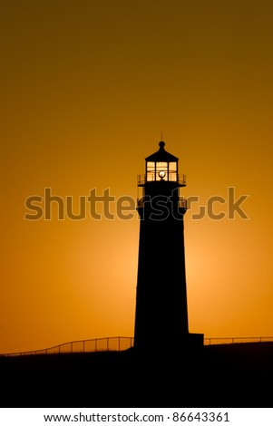 Sankaty head lighthouse at sunrise in the village of Siasconset on the eastern shore of Nantucket Island - stock photo