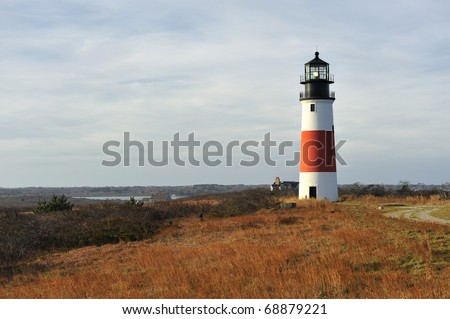 Sankaty Head Lighthouse Nantucket Massachusetts USA wide-angle view across the moors in autumn. Built in 1850, the light house was moved from the edge of an eroding bluff in 2007. - stock photo
