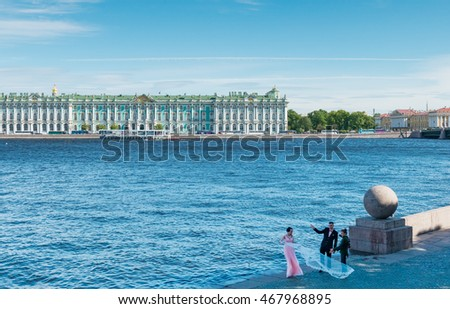 SANKT PETERSBURG, RUSSIA JUNE 11, 2015: Historical center of Sankt Petersburg on the left embankment of Neva river is a very popular public place for different celebrations and actions of weddings