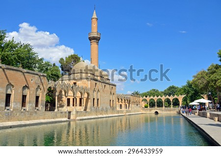 SANLIURFA,TURKEY â?? JUNE 26 2015: Pond of holy fish is near the birthplace of the prophet Abraham.Legend says Abraham was thrown into fire at this place and fire was changed into water at that time.