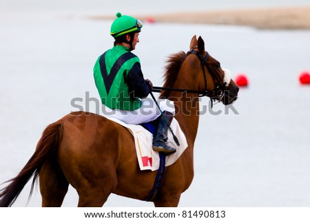 SANLUCAR DE BARRAMEDA, CADIZ, SPAIN - AUGUST 07: Unknown rider at the start of the horses races of the beach of Sanlucar de Barrameda on August 07, 2010 in Sanlucar de Barrameda, Cadiz, Spain.