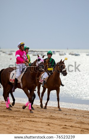 SANLUCAR DE BARRAMEDA, CADIZ, SPAIN - AUGUST 07: Unknown riders at the start of the horses races of the beach of Sanlucar de Barrameda on August 07, 2010 in  Sanlucar de Barrameda, Cadiz, Spain.
