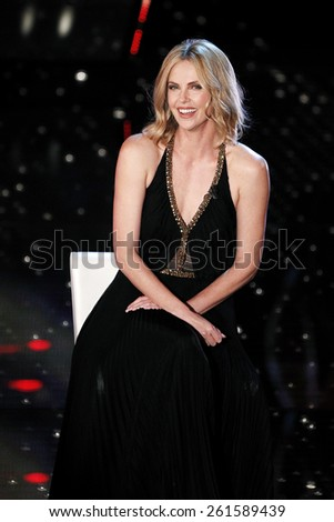 SANREMO, ITALY - FEBRUARY 11: Actress Charlize Theron guest on the stage of the 65th Sanremo Song Festival at the Ariston Theatre on February 11, 2015 in Sanremo, Italy. - stock photo