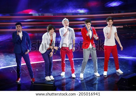 SANREMO, ITALY - FEBRUARY 17: One Direction perform on stage at the fourth day of the 62th Sanremo Song Festival at the Ariston Theatre on February 17, 2012 in SANREMO, Italy. - stock photo