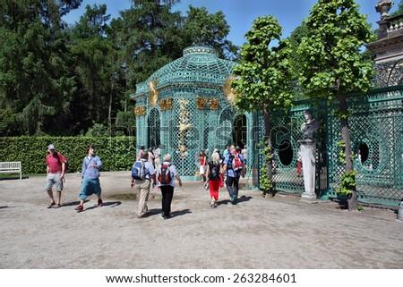 Sanssouci, Potsdam, Germany - May 19, 2013: Ornate entrance to the palace Schloss Sanssouci - stock photo