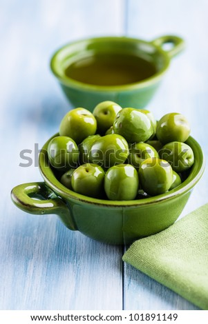Sant Agostino Olives and Olive Oil on Kitchen Table - stock photo