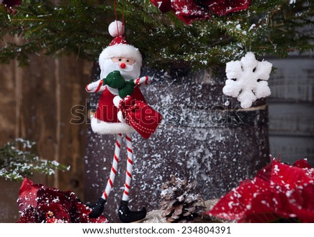 Sant Claus toy hanging on Christmas tree - stock photo