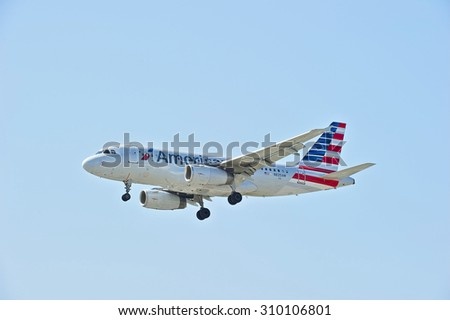 SANTA ANA/CALIFORNIA - AUG. 17, 2015: American Airlines Airbus 319-132 commercial jet approaches runway for a landing at John Wayne International Airport in Santa Ana, California, USA - stock photo