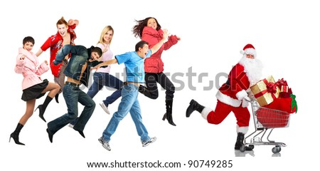 Santa and group of happy people. Christmas shopping cart with gifts. Isolated on white background.