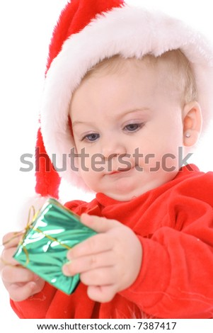 santa baby holding present - stock photo